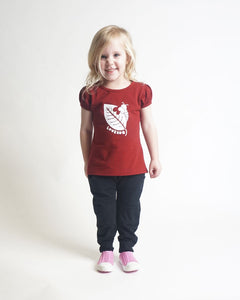 Gathered short-sleeve burgundy coloured tee for girls with screen printed graphic of a caterpillar biting a leaf shown on a girl paired with black pants.