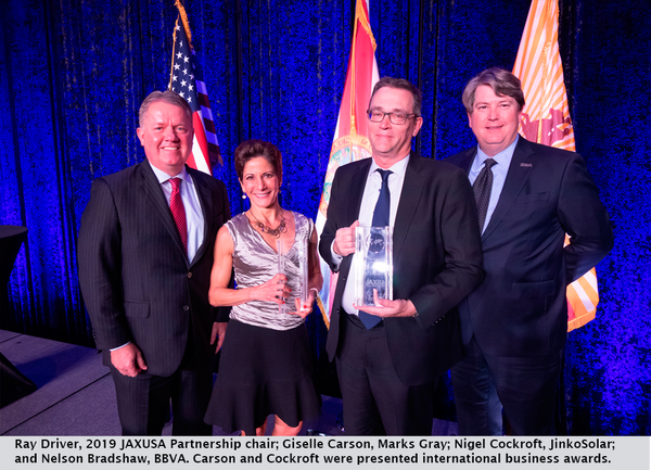 Ray Driver, 2019 JAXUSA Partnership chair; Giselle Carson, Marks Gray; Nigel Cockroft, JinkoSolar; and Nelson Bradshaw, BBVA. Carson and Cockroft were presented international business awards.