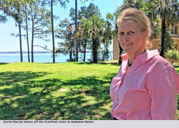 Karrie Massee shows off the riverfront views at Azaleana Manor.