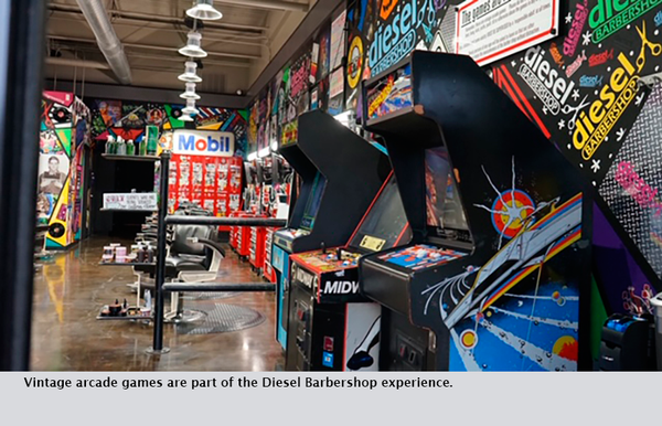 Vintage arcade games are part of the Diesel Barbershop experience.
