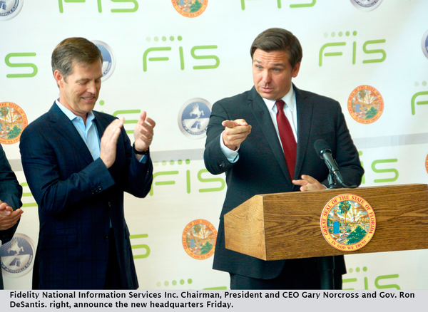 Fidelity National Information Services Inc. Chairman, President and CEO Gary Norcross and Gov. Ron DeSantis. right, announce the new headquarters Friday.