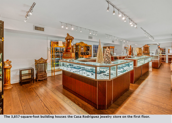 The 3,857-square-foot building houses the Casa Rodriguez jewelry store on the first floor.