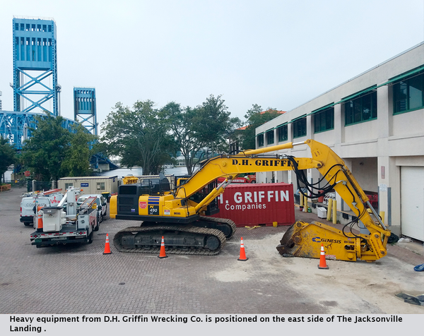 Heavy equipment from D.H. Griffin Wrecking Co. is positioned on the east side of The Jacksonville Landing .