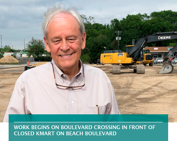 Work begins on Boulevard Crossing in front of closed Kmart on Beach Boulevard