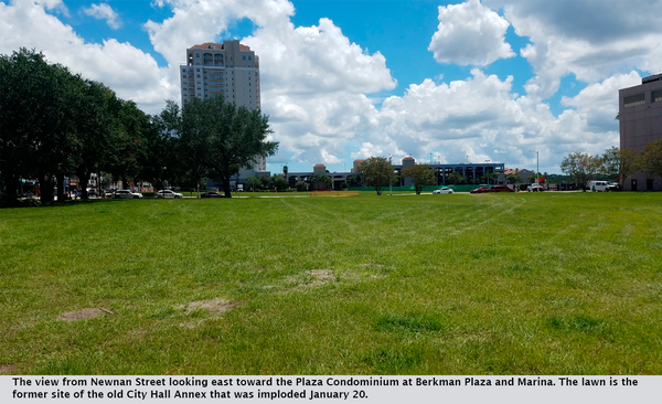 The view from Newnan Street looking east toward the Plaza Condominium at Berkman Plaza and Marina. The lawn is the former site of the old City Hall Annex that was imploded January 20.