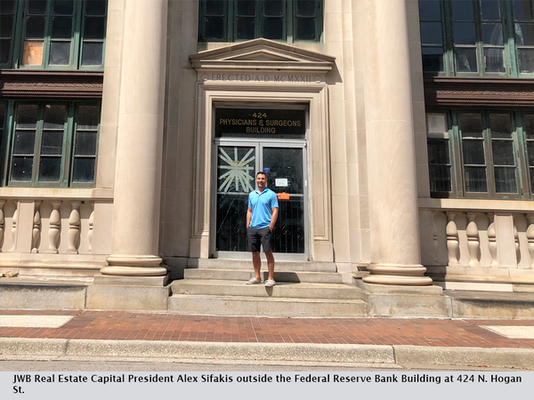 JWB Real Estate Capital President Alex Sifakis outside the Federal Reserve Bank Building at 424 N. Hogan St.