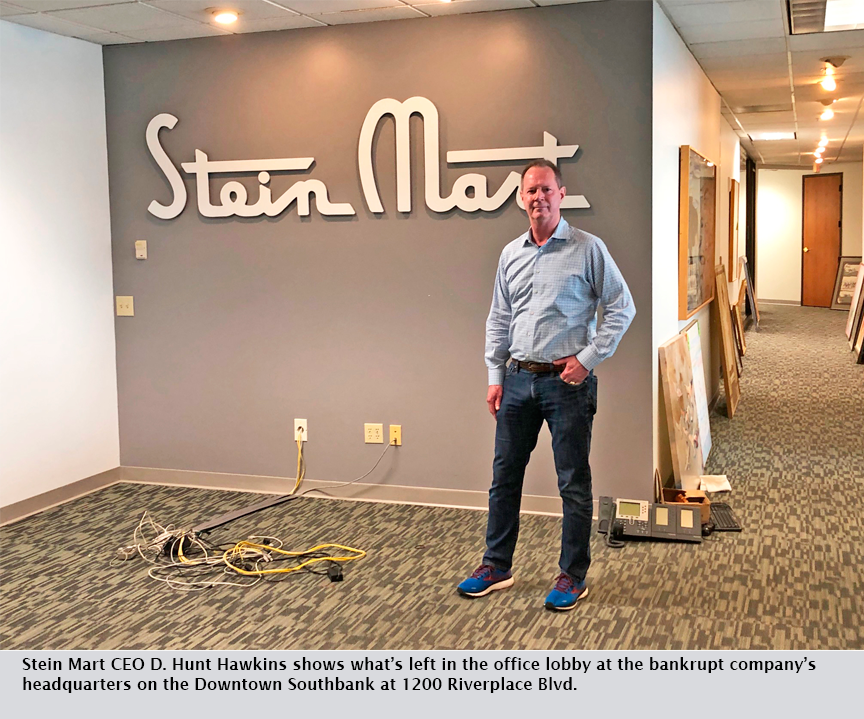 Stein Mart CEO D. Hunt Hawkins shows what's left in the office lobby at the bankrupt company's headquarters on the Downtown Southbank at 1200 Riverplace Blvd.