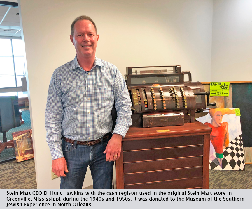 Stein Mart CEO D. Hunt Hawkins with the cash register used in the original Stein Mart store in Greenville, Mississippi, during the 1940s and 1950s. It was donated to the Museum of the Southern Jewish Experience in North Orleans.