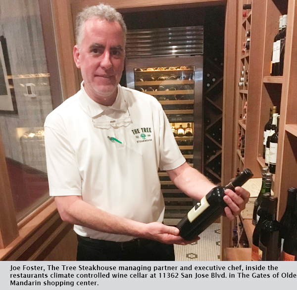 Joe Foster, The Tree Steakhouse managing partner and executive chef, inside the restaurants climate controlled wine cellar at 11362 San Jose Blvd. in The Gates of Olde Mandarin shopping center.