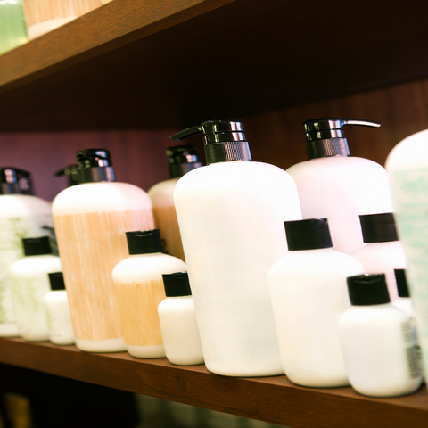 Bottles of unlabeled hair products