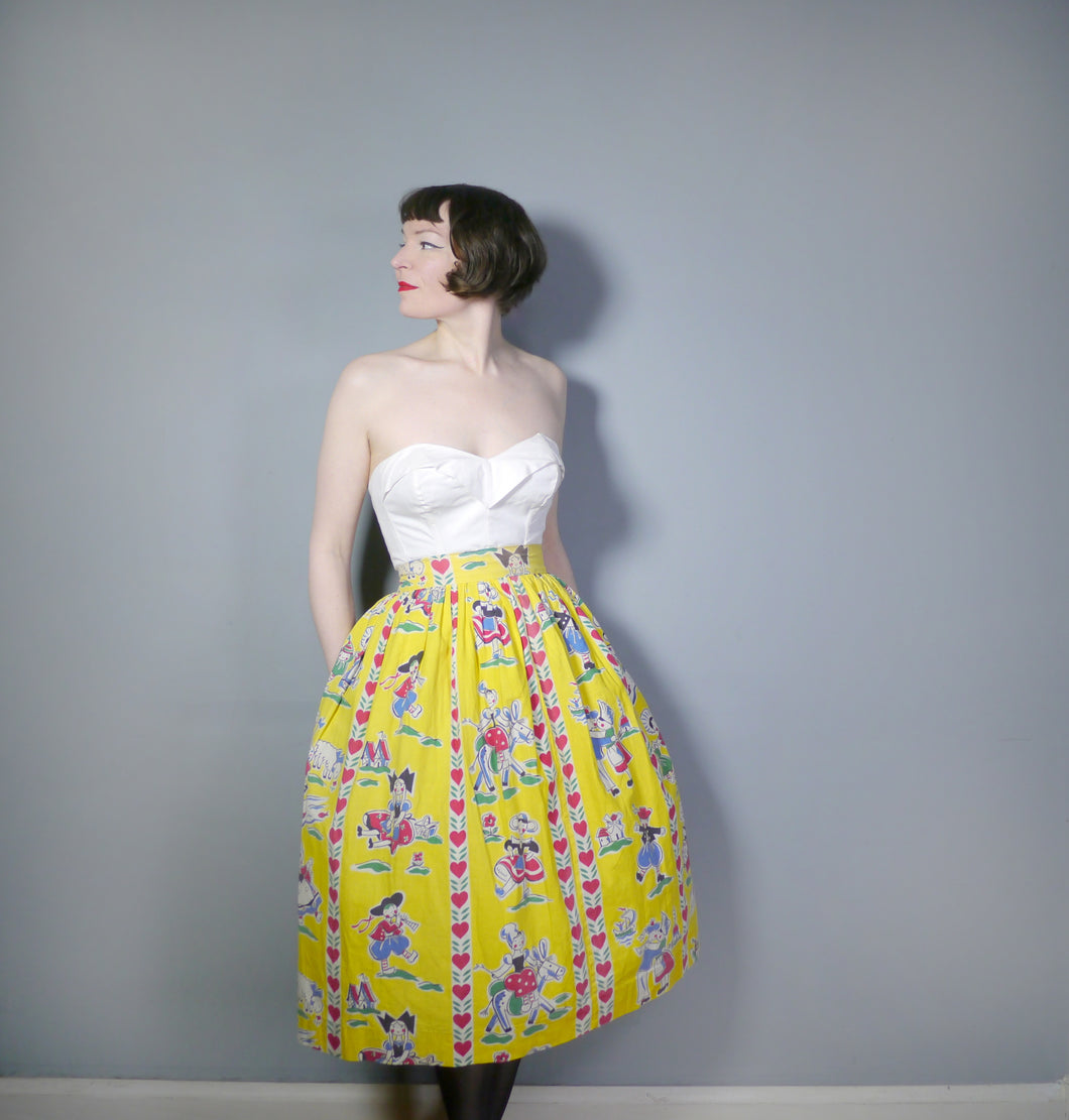50s YELLOW NOVELTY SKIRT IN NAIVE DUTCH PEOPLE AND LOVE HEART PRINT - 26.5