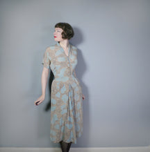 Load image into Gallery viewer, 40s NOVELTY CITYSCAPE PRINT TURQUOISE AND BEIGE RAYON DRESS - M