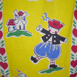 50s YELLOW NOVELTY SKIRT IN NAIVE DUTCH PEOPLE AND LOVE HEART PRINT - 26.5""