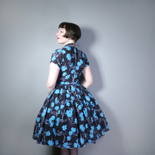 Load image into Gallery viewer, 50s BLACK AND VIVID BLUE FLORAL FULL SKIRTED DRESS WITH HIGH CHOKER NECKLINE - S