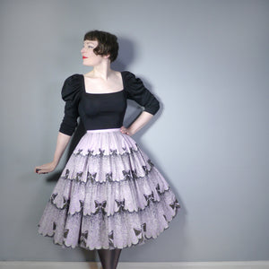 50s NOVELTY BOW PRINT SKIRT IN LAVENDER AND BLACK - 28""