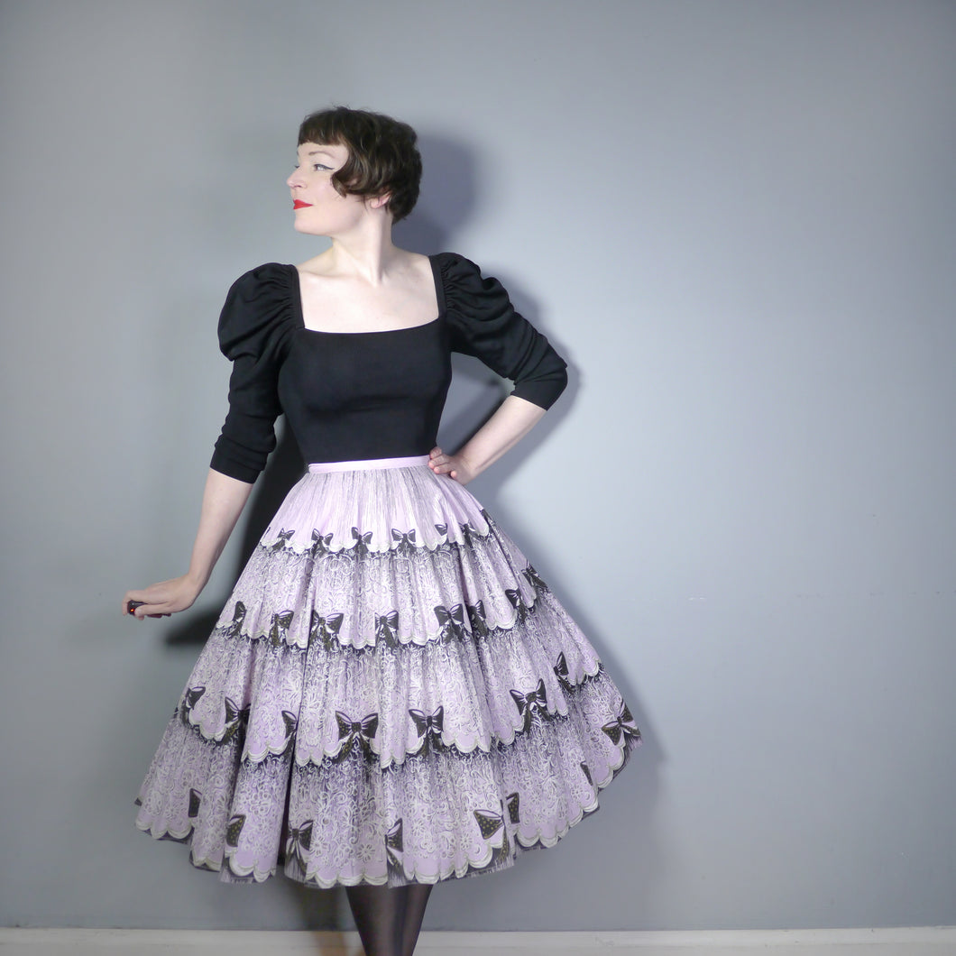 50s NOVELTY BOW PRINT SKIRT IN LAVENDER AND BLACK - 28