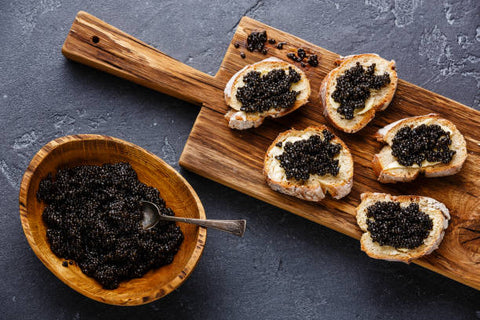 caviar with breads and a bowl of caviar