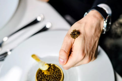 serving caviar on hand