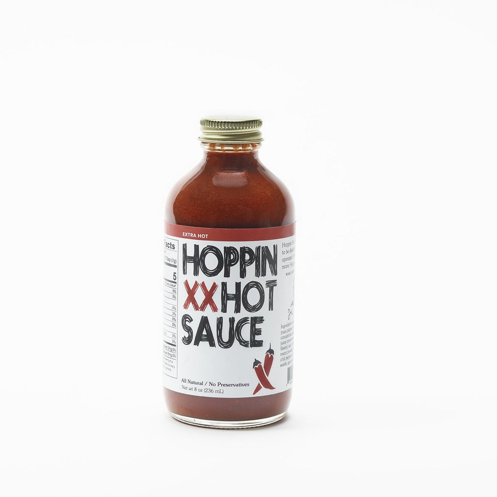 Extra Hot Flavor Hoppin Hot Sauce in the 8oz glass bottle.