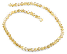 Load image into Gallery viewer, 6mm Yellow Twist Faceted Crystal Beads