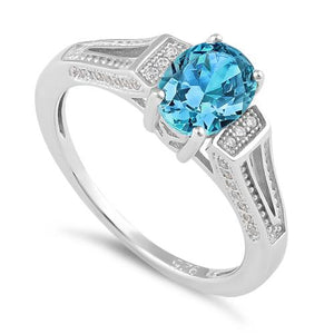 Sterling Silver Blue Topaz Oval Cut CZ Ring