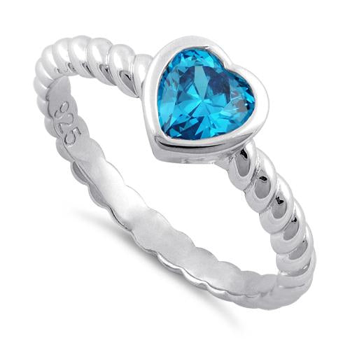products/sterling-silver-heart-blue-topaz-cz-ring-10_665a1ad6-3699-41cc-8634-d96379f78a70.jpg