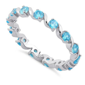 Sterling Silver Swirl Blue Topaz Eternity CZ Ring