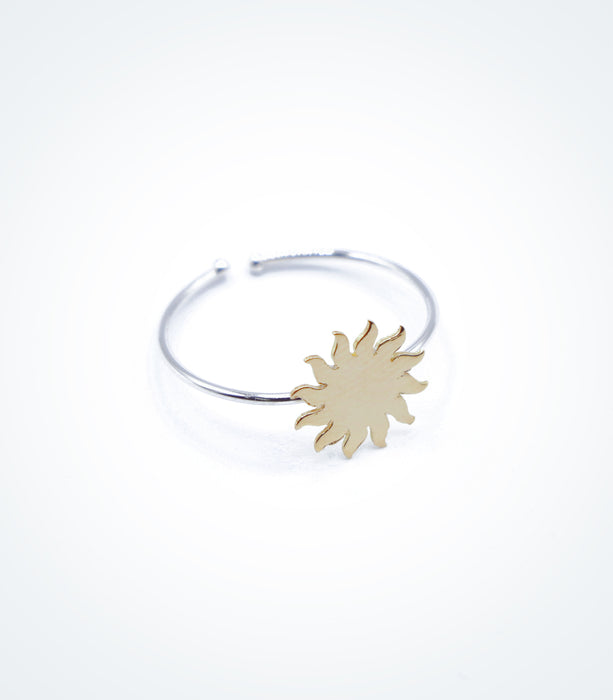 Yellow gold Sun motif on white gold ring wire