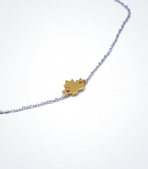 Yellow gold Maple Leaf motif with a white gold chain necklace