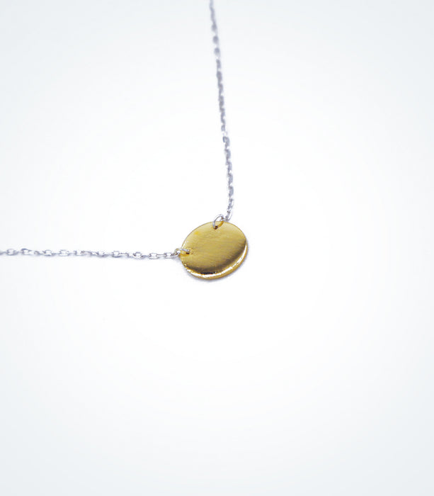 Yellow gold Solid Circle motif with a white gold chain necklace