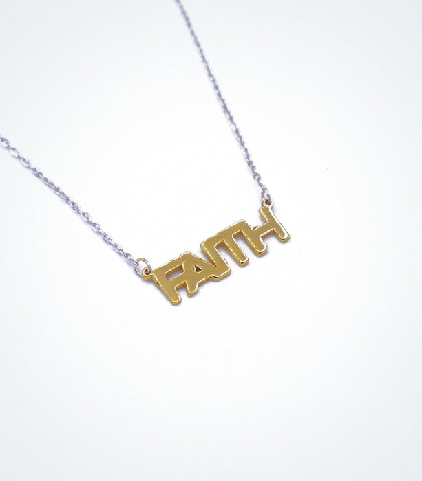 Yellow gold FAITH motif with a white gold chain necklace