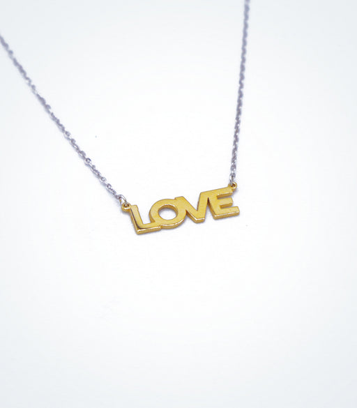 Yellow gold LOVE motif with a white gold chain necklace