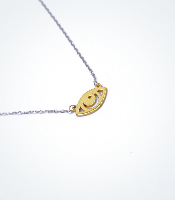 Yellow gold Evil Eye motif with a white gold chain necklace