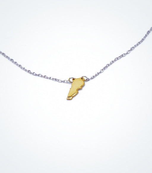 Yellow gold Map of Lebanon motif with a white gold chain necklace