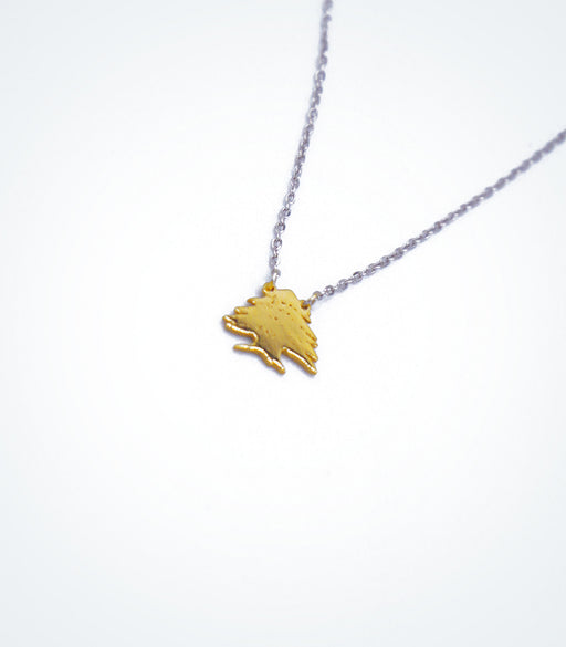 Yellow gold Cedar Tree motif with a white gold chain necklace