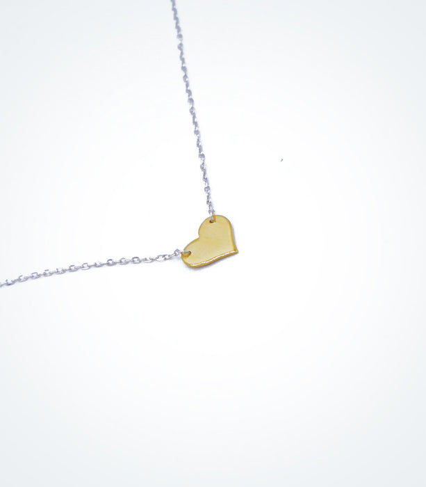 Yellow gold Solid heart motif with a white gold chain bracelet
