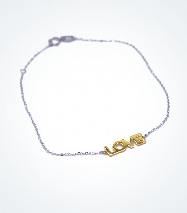 Yellow gold LOVE motif with a white gold chain bracelet