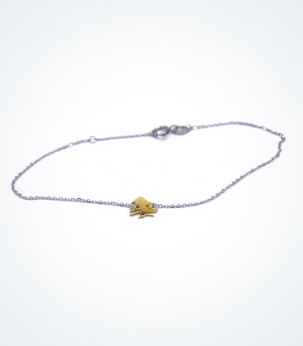 Yellow gold Cedar Tree motif with a white gold chain bracelet