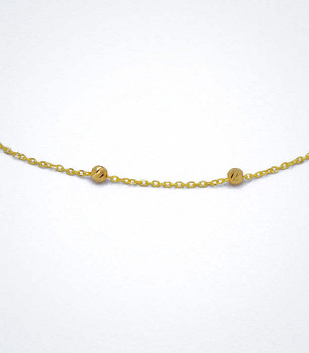 Yellow gold necklace with yellow diamond cut ball beads