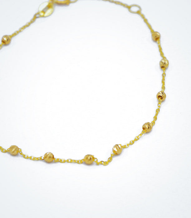 Yellow gold bracelet with yellow diamond cut ball beads