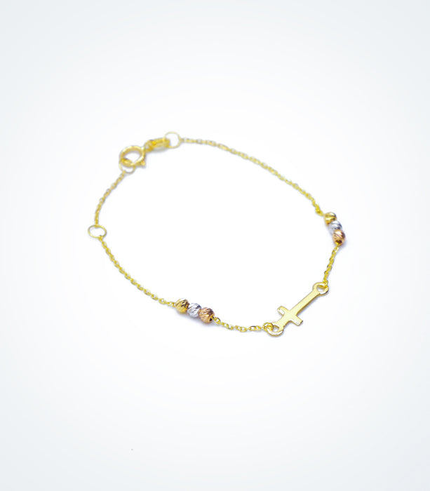 Yellow gold bracelet with a small Cross and colored ball beads