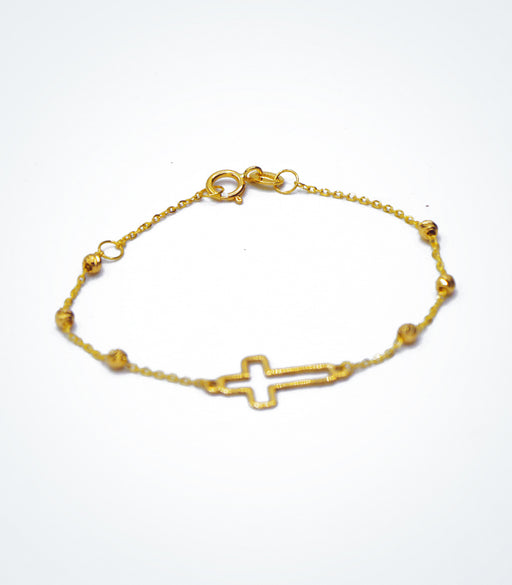 Yellow gold children's bracelet with an outline Cross and yellow ball beads