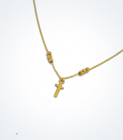 Yellow gold children's necklace with a small cross and yellow gold ball beads