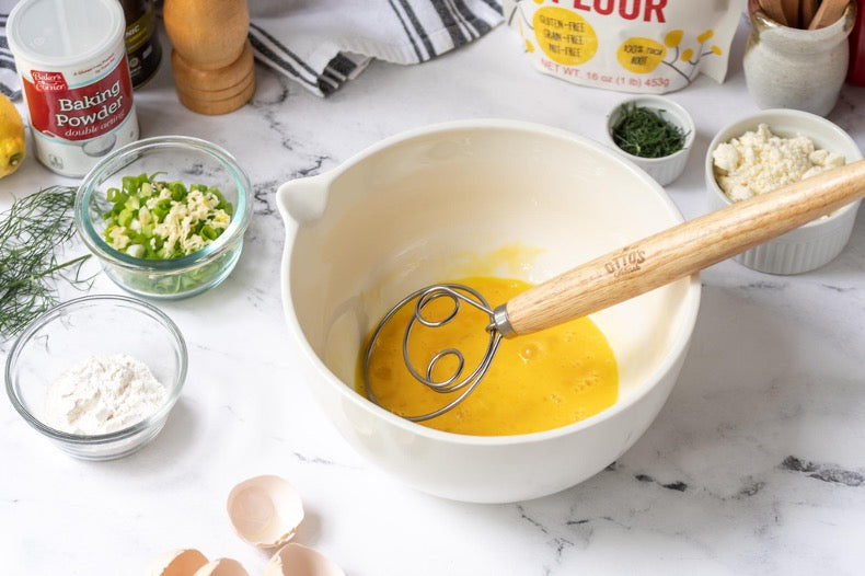 Eggs being whisked in a bowl by the Otto's Naturals Danish Whisk