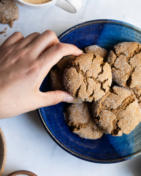 hand picking up molasses cookie