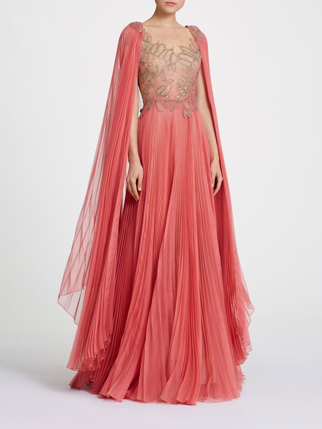 Pleated skirt gown with cape