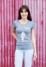 dark haired woman wearing a mid heather grey screen printed t-shirt against a red background