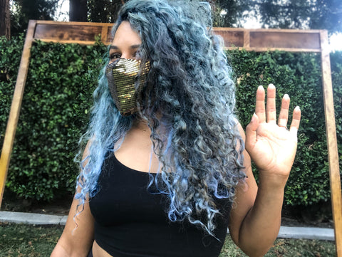 Girl wearing a mask with Sequins