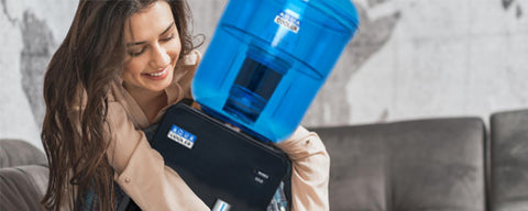 The best home water coolers. Woman hugging water cooler.