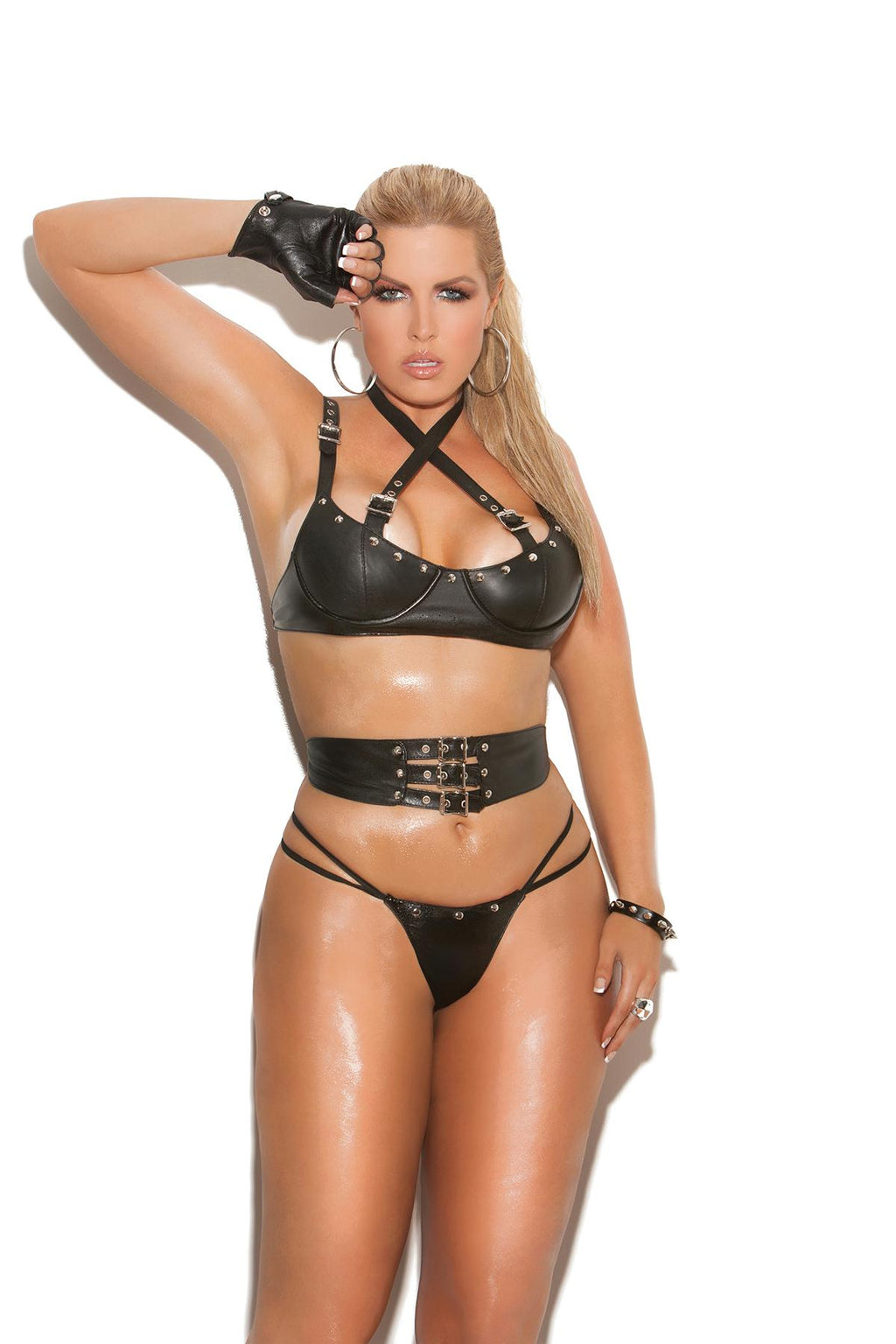 Leather underwire bra with criss cross straps with buckle detail, adjustable straps and back closure. Waist cincher with adjustable buckle detail. Matching panty included. *Available Boxed